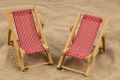 Deck chair on sandy beach Royalty Free Stock Photos