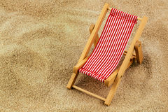 Deck chair on the sandy beach Royalty Free Stock Image