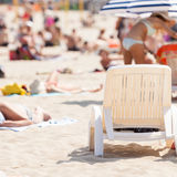 Deck chair on sandy beach, sunbathing equipment Stock Images