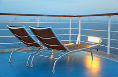 Deck-chair are on ship overlooking city Stock Photo