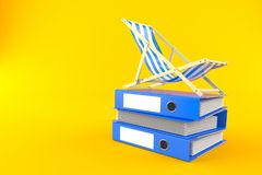 Deck chair on stack of ring binders. On orange background Royalty Free Stock Photography