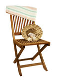 Deck chair with sun hat, towel and seashells Royalty Free Stock Image