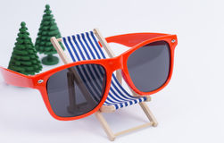 Deck Chair and sunglases Royalty Free Stock Image