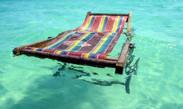 Deck-chair swimming in the pool Royalty Free Stock Photos