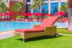 Deck chair at the swimming pool. Luxury red deck chair at the swimming pool Royalty Free Stock Photo