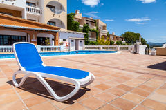 Deck Chair in a Swimming Pool. From a Rural Village in Mallorca, Spain stock photos