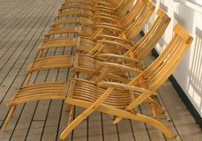 Deck chairs. Wooden chairs on deck of ship Stock Image