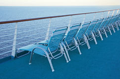 Deck chairs. Row of chairs on a deck of a cruise ship Royalty Free Stock Image