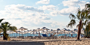 Deck chairs . View of the beach with loungers and umbrellas stock images