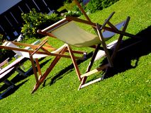 Deck chairs. A relaxing shot of two deck chairs under an umbrella Royalty Free Stock Images