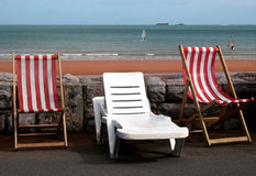Deck chairs. On beach promenade for hire Stock Image