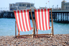Deck chairs. Red and white striped deck chairs on Worthing beach Royalty Free Stock Photos