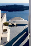 Deck Chairs above island scene. Greek Island Scene - empty deck chairs volcano in background Stock Photography