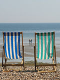 Deck Chairs on the beach. Photograph of deck chairs on the beach, holiday idea Stock Photo