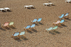 Deck chairs on beach. Photograph of deck chairs on a coastal location Stock Image