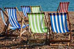 Deck Chairs on the beach. Blue, green and red deck chairs on Brighton beach, Sussex Stock Photography