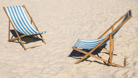 Deck chairs on the beach Royalty Free Stock Images