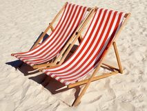 Deck chairs on the beach.  Stock Photo