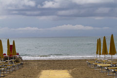 Deck chairs on the beach Stock Photography