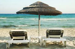 Deck chairs on the beach. A deck chairs on the beach Royalty Free Stock Photo