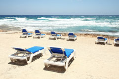 Deck chairs on the beach Stock Image