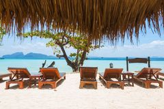 Deck chairs on the beach. Beautiful view on the blue sea. Relaxation concept with sun lounge chairs for holidays. Deck chairs on the beach. Beautiful view on the royalty free stock image