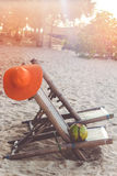 Deck chairs on the beach with coconut Stock Image