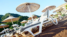 Deck chairs on the beach. Diagonal photo. Stock Photo