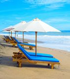 Deck chairs beach parasols, Bali stock photos