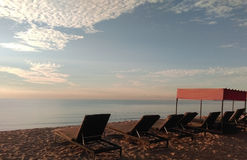 Deck Chairs on the Beach. A row of deck chairs facing the South China Seas in Desaru, Malaysia Stock Photography