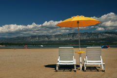 Deck chairs on the beach. Deck chairs on the summer beach Royalty Free Stock Image
