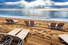 Deck chairs on beach Stock Photography