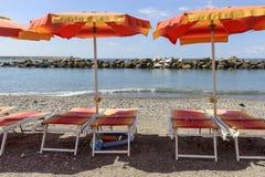 Deck chairs and beach umbrellas at beach resort, Chiavari, Ital Stock Photography