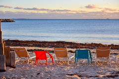 Deck chairs at a beach Stock Image