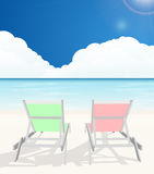 Deck chairs on beach Stock Images