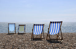Deck chairs on Brighton beach. A nice sunny day on Brighton beach Royalty Free Stock Photography