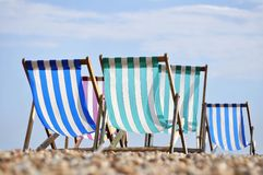 Deck chairs on Brighton beach. In summer, England, UK Stock Image