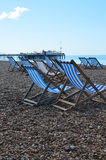 Deck chairs on Brighton Beach. Royalty Free Stock Photography
