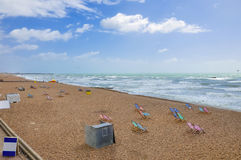 Deck chairs on the Brighton beach. Deck chairs on the empty Brighton beach, United Kingdom Royalty Free Stock Photos