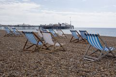 Deck chairs on brighton beach. UK Stock Images