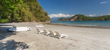 Deck chairs on the Carribean beach in Costa rica Royalty Free Stock Photos