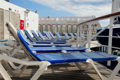 Deck chairs on cruise ship. Lawn chairs on the deck of a cruise ship Royalty Free Stock Photos