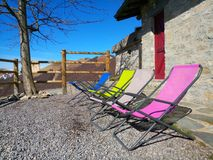 Deck chairs. In a miuntain chalet Stock Photos
