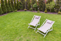 Deck chairs in the garden Royalty Free Stock Photo