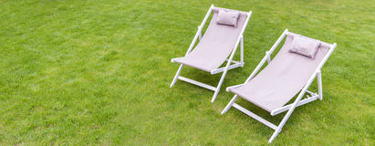 Deck chairs in the garden Stock Image