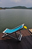 Deck chairs on the lake. One deckchair on the lake in the morning royalty free stock photos
