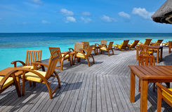 Deck chairs by the ocean Royalty Free Stock Photo