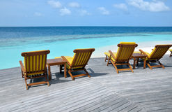Deck chairs by the ocean Stock Photography
