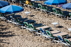 Deck chairs over the sand in a idyllic beach in Ibiza, Balearic Royalty Free Stock Photos