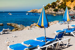 Deck chairs over the sand in a idyllic beach in Ibiza, Balearic Stock Photo
